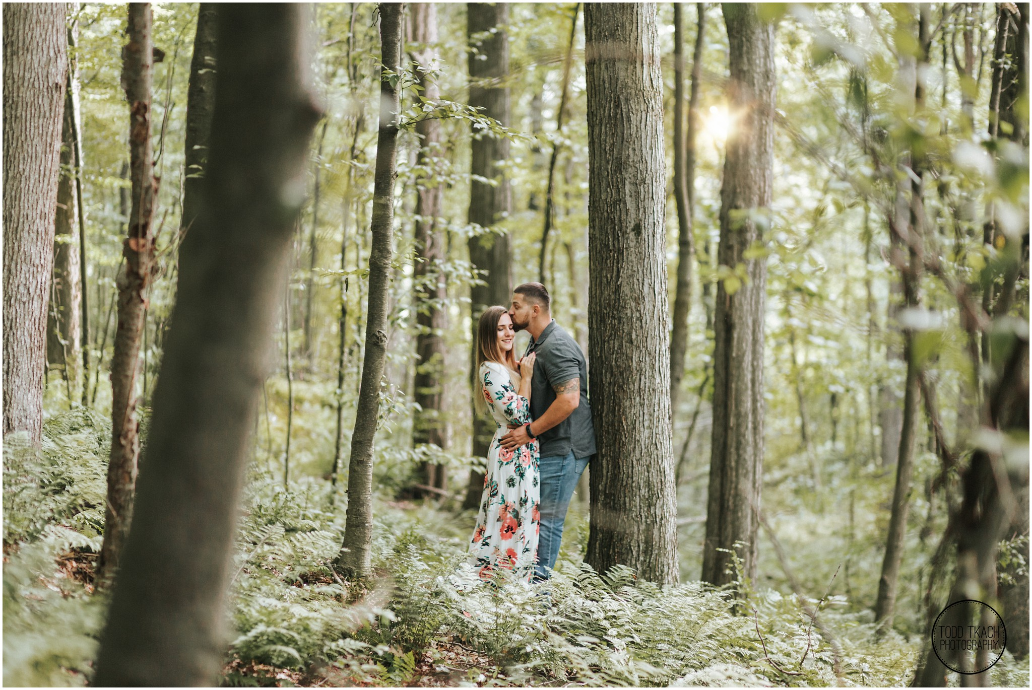 Kim & Brandon Engagement - Sunlight Forest Kiss Portrait
