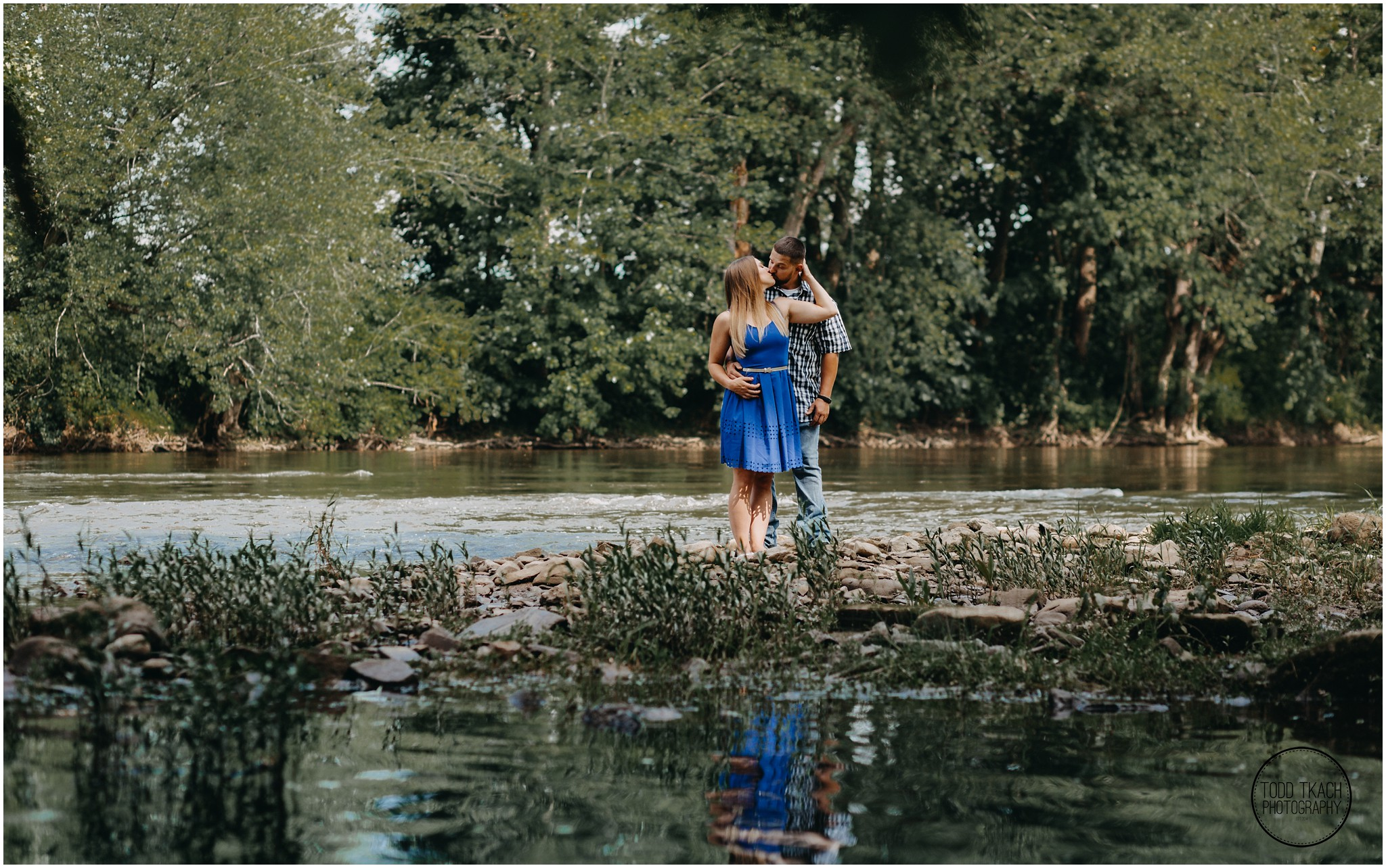 Kim & Brandon Engagement - Creek Kiss Portrait