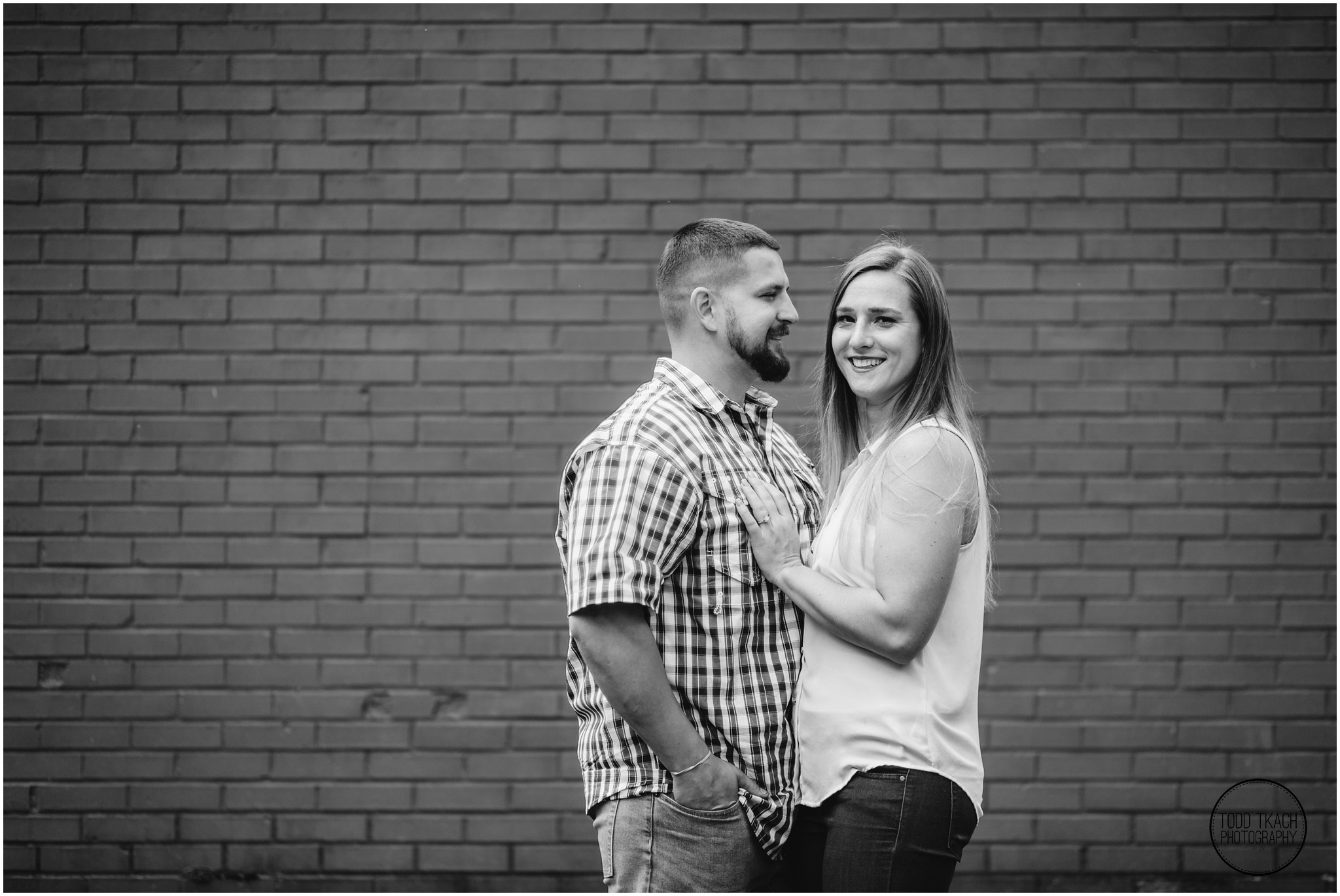 Kim & Brandon Engagement - Kim & Brandon Black and White Brick Portrait