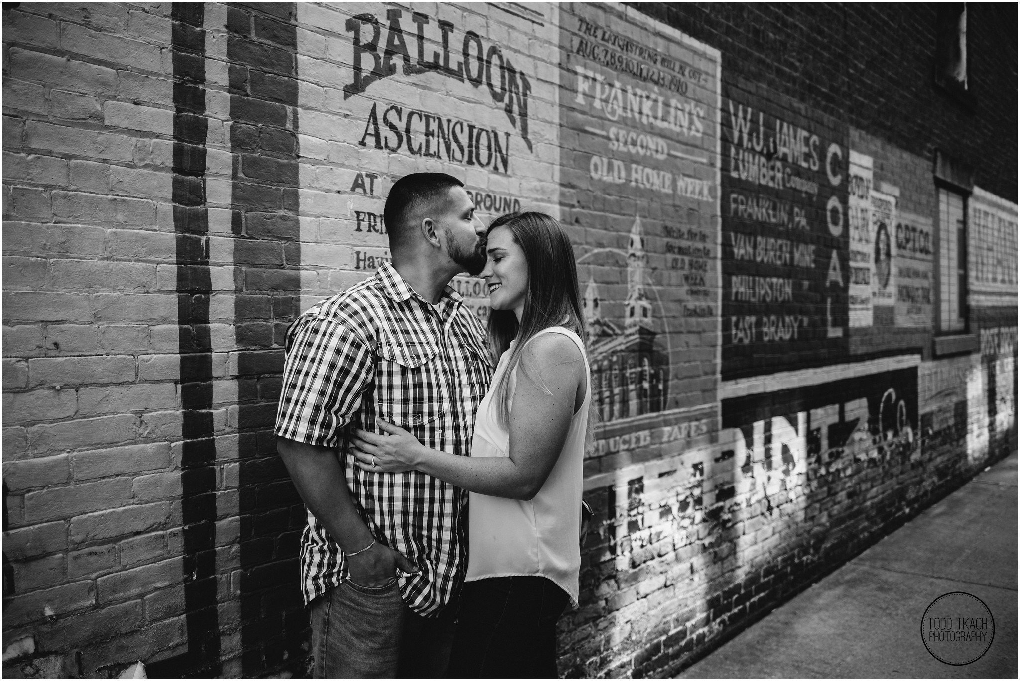 Kim & Brandon Engagement - Old Time Billboard Kiss Portrait