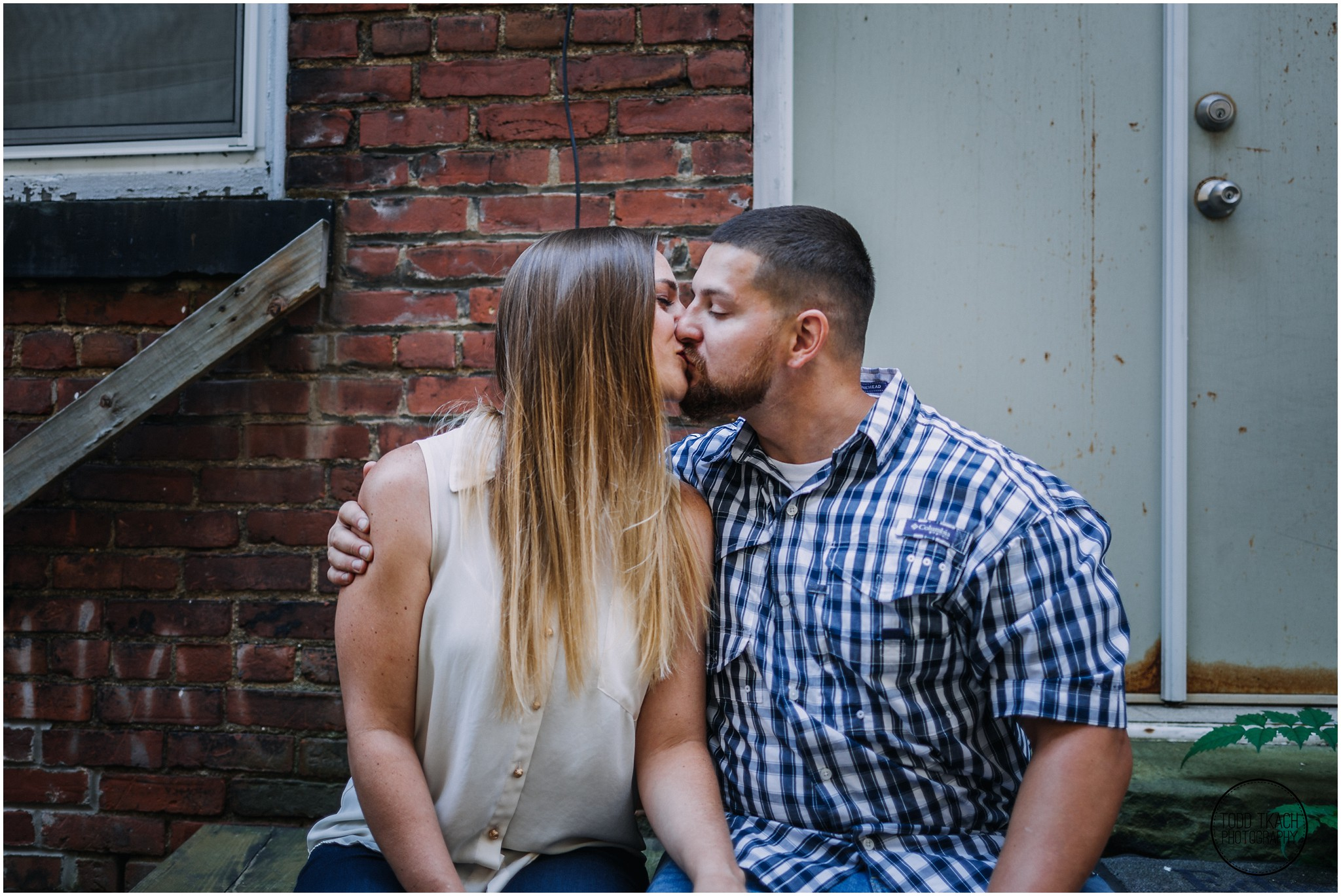 Kim & Brandon Engagement - Franklin PA Alleyway Kiss